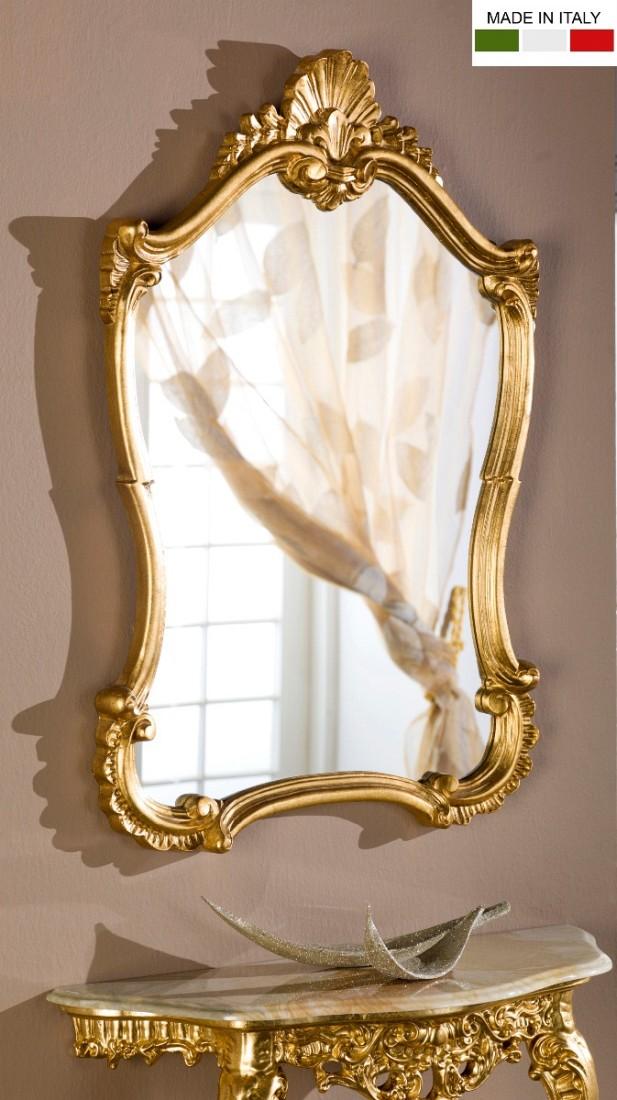 Επιτοίχιος ιταλικός καθρέπτης, σε περίτεχνο σχέδιο και σκαλιστή ανάγλυφη χρυσή κορνίζα.