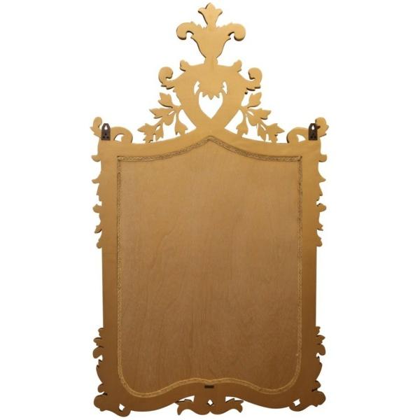 Επιτοίχιος καθρέπτης, με εντυπωσιακή χρυσή σκαλιστή κορνίζα, σε φλοράλ μοτίβο, που θυμίζει μεσαιωνικό οικόσημο κάποιου ευγενούς οίκου.