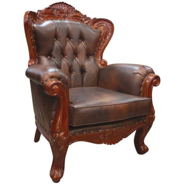 Πολυθρόνα μπερζέρα, με ξύλινο σκαλιστό σκελετό, καπιτονέ πλάτη και αποσπώμενο μαξιλάρι καθίσματος, σε σκούρο καφέ χρώμα.