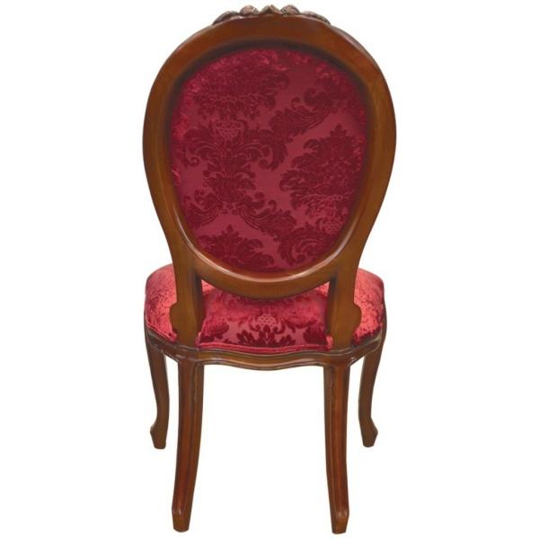 Καρέκλα με διακριτή οβάλ πλάτη, σκάλισμα στον ξύλινο σκελετό και μπορντό βελούδινη ταπετσαρία με σχέδια.
